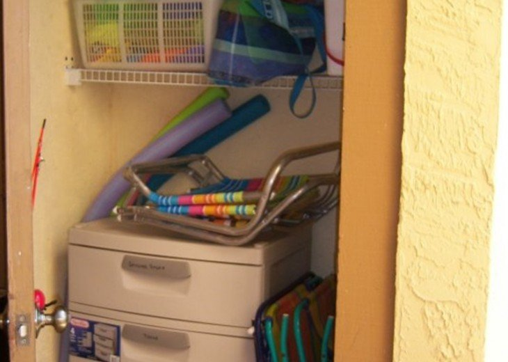 Storage Closet with chairs, cart, toys and more