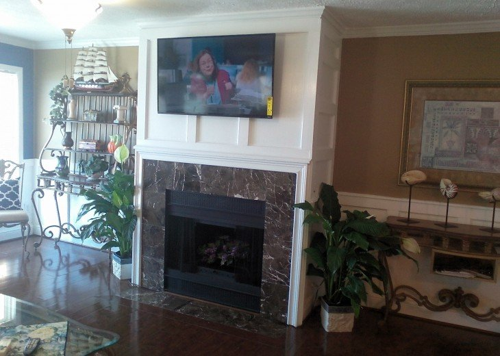 Fire place with flat screen tv in living room
