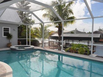 heated salt water pool and spa, boat dock + tiki-hut on large Gulf access canal