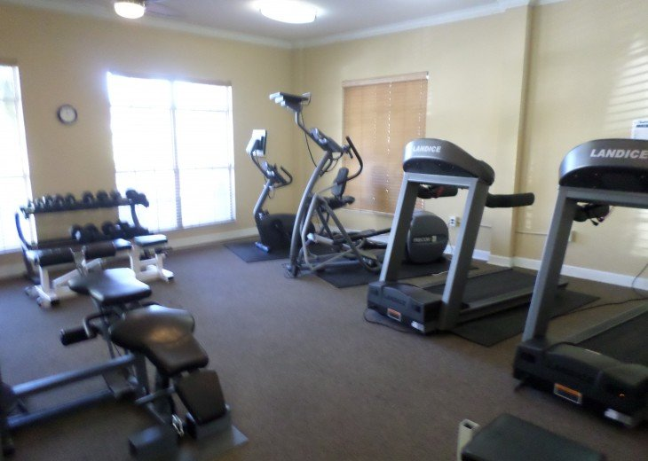 Full fitness center across walk from condo.