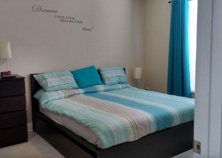King bed, blackout drapes, remote control fan, sweet dreams.
