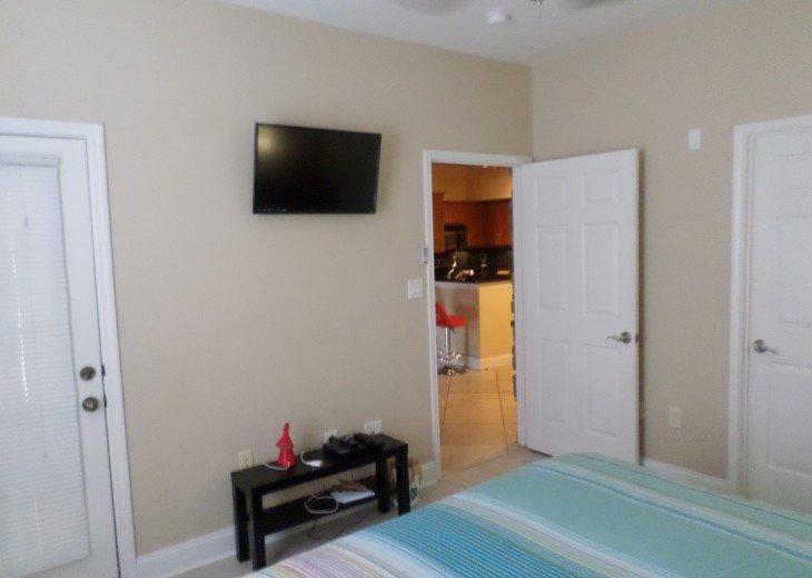 DVD in bedroom with doors to patio, bath n living area.