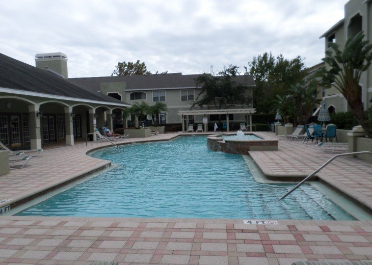 Covered areas n umbrella tables in pool area. 3 sets of stairs.