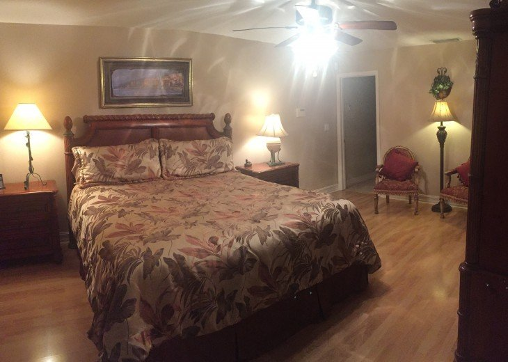 Master King bedroom with sitting area, large closet and hidden tv in armoire