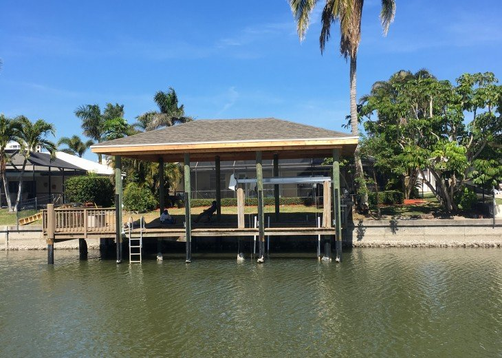 Covered dock on canal for fishing, boating, dolphin watching and dining