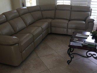 New leather sofa, tile floor, ceiling fan, large HDTV
