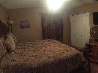 king guest bedroom facing pool, plenty of drawer space. flat screen TV/DVD set