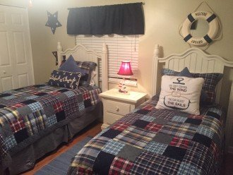 Twin bedroom with spacious closet and linen closet, ceiling fan