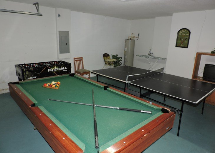 Games room with pool table and ping pong.