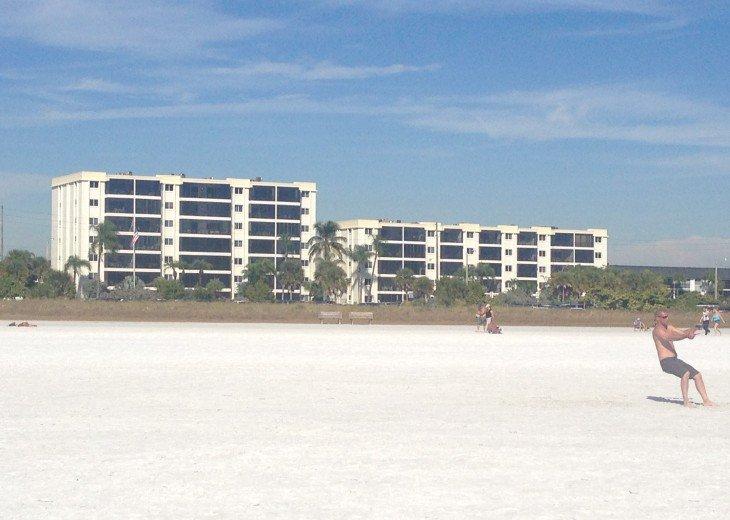 Condo from the beach - look at that white sand!