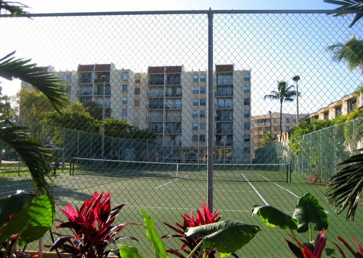 TENNIS COURTS AND CONDO BUILDING