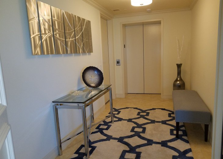 Private elevator lobby with upscale details.