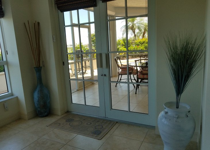 Grand exit to the expansive lanai and outdoor terrace (with hot tub).
