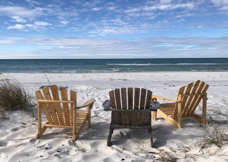Adirondack chairs off the dune walkover overlooking the Gulf