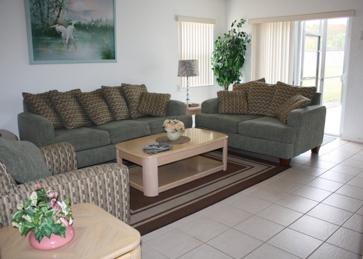 Family room showing patio doors leading to pool and deck area