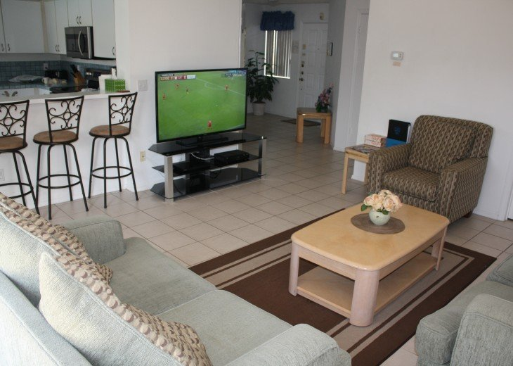 """Family room with 55"""" HD TV and blu-ray player"""