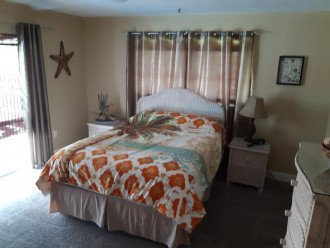 Master bedroom with private bath and office area.