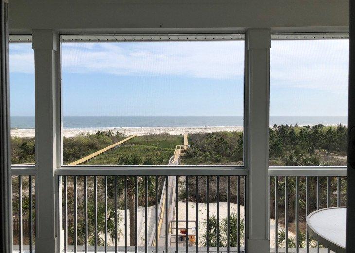 View from top floor screened-in deck. 2019