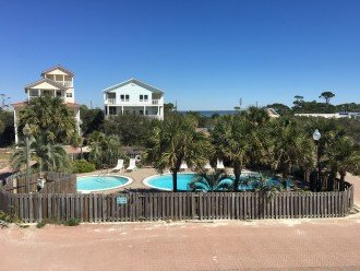 Community pool from back deck, you can also see the bay