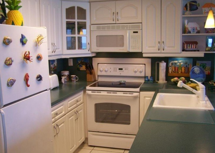 Kitchen features new refrigerator, oven, range, microwave and dishwasher.