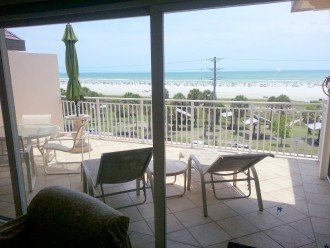 View from living room of large open balcony and Gulf of Mexico