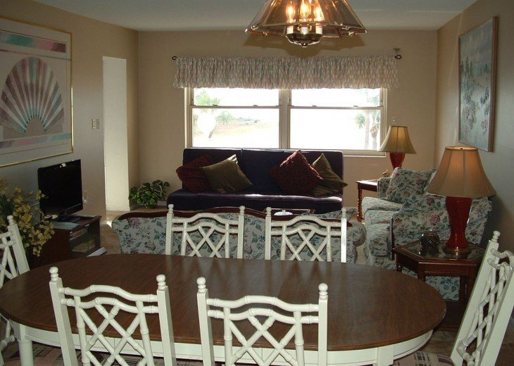 Dining area and living room, patio exit far left