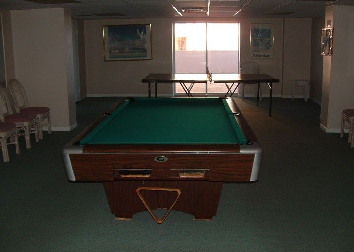 Pool and ping pong tables on upper lobby level