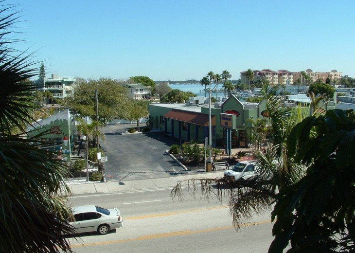 Gulf Blvd, Middle Grounds Grill with Boca Ciega Bay in background