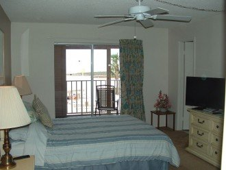 Master bedroom, en-suite bath on right & patio over pool