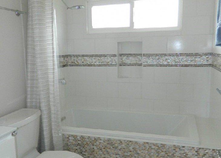 Full bath with soaking tub