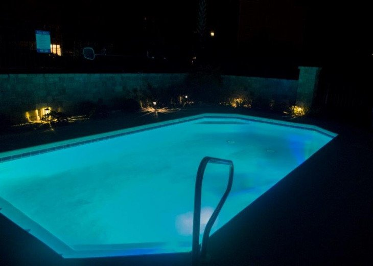 The pool has colored light features