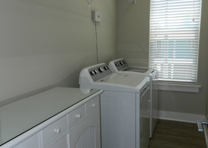 Laundry room located on bedroom floor