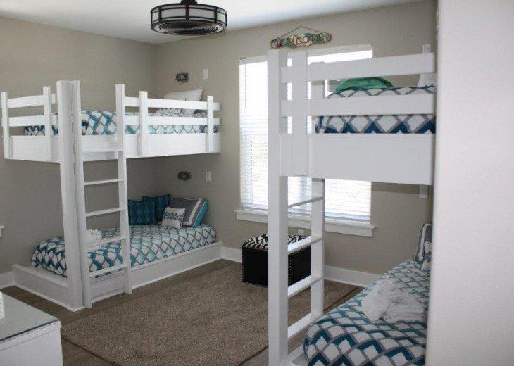 Bunk room has custom built in bunks