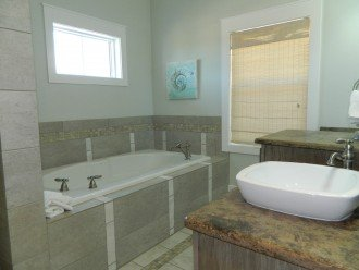 Downstairs King Master has a Walk-in Shower as well as a Garden Tub