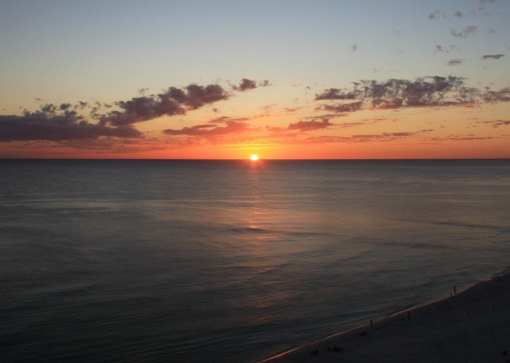 View from balcony of beach and Gulf of Mexico at sunset