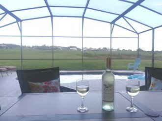 Enjoy a glass of chilled wine while watching the golfers go by.