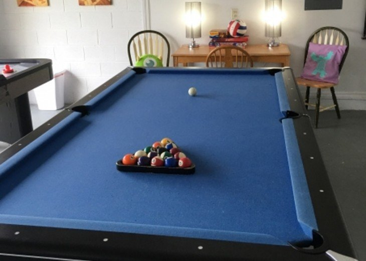 In the game room a full sized pool table awaits...