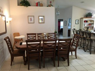The adjoining dining room and breakfast counter will seat eleven more!