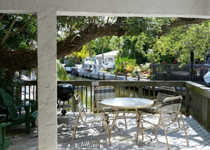 """""""SITTING ON THE DOCK OF THE BAY"""" """"Coastal Courtyard"""" 6151 Midnight Pass Rd. #4"""