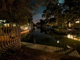 """""""SITTING ON THE DOCK OF THE BAY"""" """"Coastal Courtyard"""" 6151 Midnight Pass Rd. #1"""