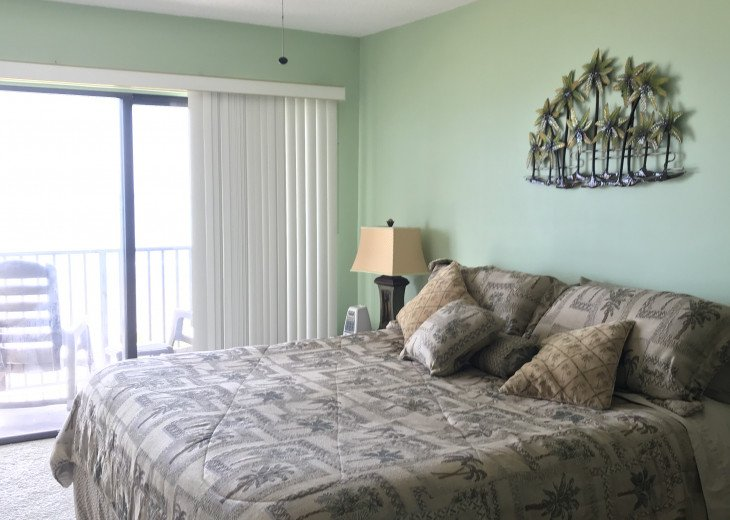 Master Bedroom with access to balcony. Listen to the waves at nite.