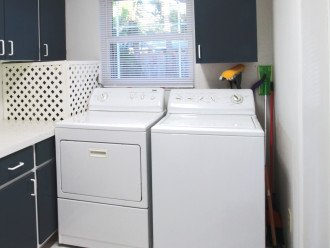 Laundry room with storage.