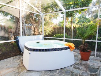 Soak in the privacy of our hot tub surrounded by tropical gardens