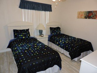 Twin bedroom, with adjacent bathroom