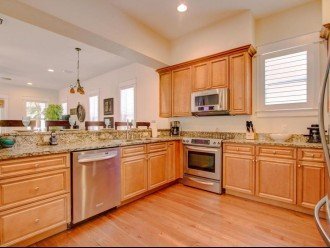 Open kitchen with granite counters.