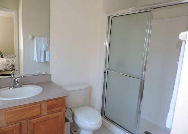One of 3 bathrooms, this one with walk in shower