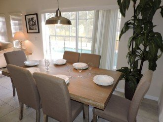 Your dining table overlooks your private pool