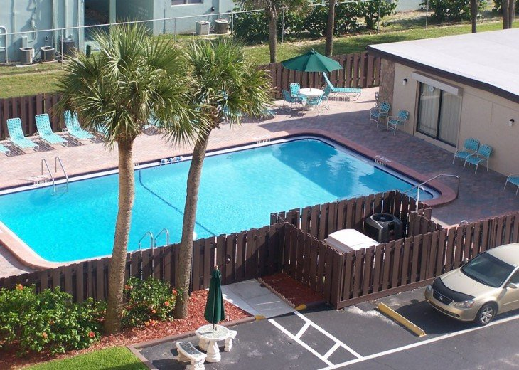 View of the pool below from your condo