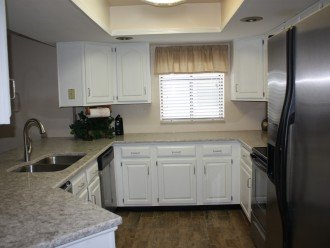 Kitchen with Dishwasher, Microwave, full size appliances and Wine Cooler