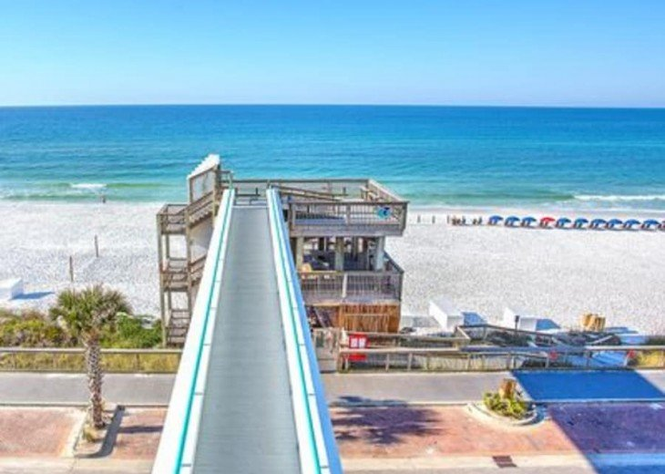 Sky Bridge over the street to Emerald Green Water & White Pristine Sandy Beach